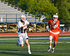 West Genesee Wildcats John Bergan (17) shoots the ball against the Liverpool Warriors in Section III Class A Semi-Finals Boys Lacrosse action at Michael Bragman Stadium in Cicero, New York on Thursday, May 24, 2018.  West Genesee won 16-5.