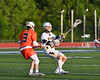 West Genesee Wildcats John Bergan (17) passing the ball against Liverpool Warriors Ian Conroy (3) in Section III Class A Semi-Finals Boys Lacrosse action at Michael Bragman Stadium in Cicero, New York on Thursday, May 24, 2018.  West Genesee won 16-5.