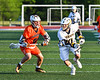West Genesee Wildcats Noah Sabatino (20) being defended by Liverpool Warriors Cade Clouthier (6) in Section III Class A Semi-Finals Boys Lacrosse action at Michael Bragman Stadium in Cicero, New York on Thursday, May 24, 2018.  West Genesee won 16-5.