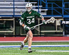 Fayetteville-Manlius Hornets Michael Howe (34) with the ball against the West Genesee Wildcats in Section III Class A Finals Boys Lacrosse action at Michael Bragman Stadium in Cicero, New York on Wednesday, May 30, 2018.  West Genesee won 12-10.