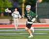 Fayetteville-Manlius Hornets Luke Miranda (21) running with the ball against the West Genesee Wildcats in Section III Class A Finals Boys Lacrosse action at Michael Bragman Stadium in Cicero, New York on Wednesday, May 30, 2018.  West Genesee won 12-10.