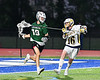 Fayetteville-Manlius Hornets Chris Lubrino (19) being defended by West Genesee Wildcats Griffin Sasso (16) in Section III Class A Finals Boys Lacrosse action at Michael Bragman Stadium in Cicero, New York on Wednesday, May 30, 2018.  West Genesee won 12-10.