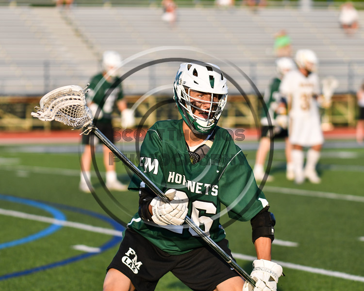 Fayetteville-Manlius Hornets Kyle Chiesa (26) playing against the West Genesee Wildcats in Section III Class A Finals Boys Lacrosse action at Michael Bragman Stadium in Cicero, New York on Wednesday, May 30, 2018.  West Genesee won 12-10.