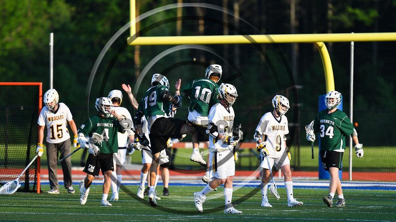 Fayetteville-Manlius Hornets Chris Lubrino (19) celebrates his goal against the West Genesee Wildcats in Section III Class A Finals Boys Lacrosse action at Michael Bragman Stadium in Cicero, New York on Wednesday, May 30, 2018.  West Genesee won 12-10.