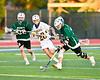 Fayetteville-Manlius Hornets Zachary Vanvalkenburgh (37) scoops up a ground ball against the West Genesee Wildcats in Section III Class A Finals Boys Lacrosse action at Michael Bragman Stadium in Cicero, New York on Wednesday, May 30, 2018.  West Genesee won 12-10.