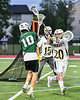 Fayetteville-Manlius Hornets Kyle Gilroy (10) passes the ball over West Genesee Wildcats defender Noah Sabatino (20) in Section III Class A Finals Boys Lacrosse action at Michael Bragman Stadium in Cicero, New York on Wednesday, May 30, 2018.  West Genesee won 12-10.