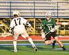Fayetteville-Manlius Hornets Mikey Porter (13) making a move on West Genesee Wildcats John Bergan (17) in Section III Class A Finals Boys Lacrosse action at Michael Bragman Stadium in Cicero, New York on Wednesday, May 30, 2018.  West Genesee won 12-10.
