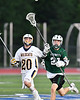 Fayetteville-Manlius Hornets Luke Miranda (21) passing the ball against the West Genesee Wildcats in Section III Class A Finals Boys Lacrosse action at Michael Bragman Stadium in Cicero, New York on Wednesday, May 30, 2018.  West Genesee won 12-10.