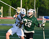 Fayetteville-Manlius Hornets Jack Shanley (22) being defended by West Genesee Wildcats Kevin Snow (14) in Section III Class A Finals Boys Lacrosse action at Michael Bragman Stadium in Cicero, New York on Wednesday, May 30, 2018.  West Genesee won 12-10.