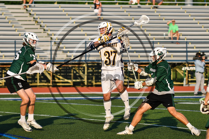 West Genesee Wildcats Jack Howes (37) making a jump shot against the Fayetteville-Manlius Hornets in Section III Class A Finals Boys Lacrosse action at Michael Bragman Stadium in Cicero, New York on Wednesday, May 30, 2018.  West Genesee won 12-10.