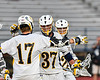 West Genesee Wildcats John Bergan (17) congratulates Jack Howes (37) on his goal against the Fayetteville-Manlius Hornets in Section III Class A Finals Boys Lacrosse action at Michael Bragman Stadium in Cicero, New York on Wednesday, May 30, 2018.  West Genesee won 12-10.