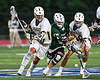 Fayetteville-Manlius Hornets Zachary Vanvalkenburgh (37) battles for the ball against West Genesee Wildcats Patrick Stanistreet (25) and Tom Baker (28) in Section III Class A Finals Boys Lacrosse action at Michael Bragman Stadium in Cicero, New York on Wednesday, May 30, 2018.  West Genesee won 12-10.