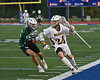 West Genesee Wildcats Anthony Dattellas (24) running with the ball against a Fayetteville-Manlius Hornets defender in Section III Class A Finals Boys Lacrosse action at Michael Bragman Stadium in Cicero, New York on Wednesday, May 30, 2018.  West Genesee won 12-10.