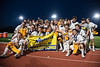 West Genesee Wildcats players celebrate their Section III Class A Boys Lacrosse Championship with the NYSPHSAA Banner at Michael Bragman Stadium in Cicero, New York on Wednesday, May 30, 2018.