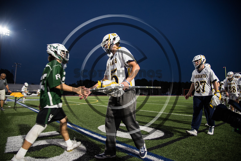 Fayetteville-Manlius Hornets and West Genesee Wildcats players shake hands after the Section III Class A Finals Boys Lacrosse game at Michael Bragman Stadium in Cicero, New York on Wednesday, May 30, 2018.  West Genesee won 12-10.