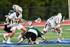West Genesee Wildcats Patrick Stanistreet (25) wins a face-off against Fayetteville-Manlius Hornets Zachary Vanvalkenburgh (37) in Section III Class A Finals Boys Lacrosse action at Michael Bragman Stadium in Cicero, New York on Wednesday, May 30, 2018.  West Genesee won 12-10.