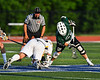 Fayetteville-Manlius Hornets Zachary Vanvalkenburgh (37) wins the face-off against West Genesee Wildcats Patrick Stanistreet (25) in Section III Class A Finals Boys Lacrosse action at Michael Bragman Stadium in Cicero, New York on Wednesday, May 30, 2018.  West Genesee won 12-10.
