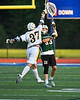 Fayetteville-Manlius Hornets goalie Ben Hammond (33) passes the ball over West Genesee Wildcats Jack Howes (37) in Section III Class A Finals Boys Lacrosse action at Michael Bragman Stadium in Cicero, New York on Wednesday, May 30, 2018.  West Genesee won 12-10.
