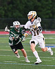 West Genesee Wildcats John Bergan (17) driving past a Fayetteville-Manlius Hornets defender in Section III Class A Finals Boys Lacrosse action at Michael Bragman Stadium in Cicero, New York on Wednesday, May 30, 2018.  West Genesee won 12-10.