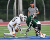 Fayetteville-Manlius Hornets Zachary Vanvalkenburgh (37) wins another face-off against West Genesee Wildcats Patrick Stanistreet (25) in Section III Class A Finals Boys Lacrosse action at Michael Bragman Stadium in Cicero, New York on Wednesday, May 30, 2018.  West Genesee won 12-10.