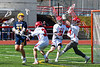 Baldwinsville Bees goalie Daniel Stehle (34) makes a save against Victor Blue Devils Camden Hay (21) in Section III Boys Lacrosse action at the Pelcher-Arcaro Stadium in Baldwinsville, New York on Friday, April 6, 2019.  Victor won 9-7.
