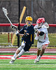 Baldwinsville Bees Braden McCard (31) defending against a Victor Blue Devils player in Section III Boys Lacrosse action at the Pelcher-Arcaro Stadium in Baldwinsville, New York on Friday, April 6, 2019.  Victor won 9-7.