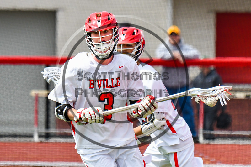 Baldwinsville Bees Adam Davis (3) with the ball against the Victor Blue Devils in Section III Boys Lacrosse action at the Pelcher-Arcaro Stadium in Baldwinsville, New York on Friday, April 6, 2019.  Victor won 9-7.