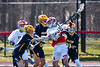 Baldwinsville Bees Spencer Wirtheim (10) fighting to get a shot off against the Victor Blue Devils in Section III Boys Lacrosse action at the Pelcher-Arcaro Stadium in Baldwinsville, New York on Friday, April 6, 2019.  Victor won 9-7.