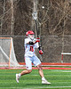 Baldwinsville Bees Braden Lynch (13) passing the ball against the Victor Blue Devils in Section III Boys Lacrosse action at the Pelcher-Arcaro Stadium in Baldwinsville, New York on Friday, April 6, 2019.  Victor won 9-7.