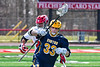 Victor Blue Devils Sutton Boland (33) with the ball against Baldwinsville Bees Michael Tangredi (26) in Section III Boys Lacrosse action at the Pelcher-Arcaro Stadium in Baldwinsville, New York on Friday, April 6, 2019.  Victor won 9-7.