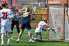 Victor Blue Devils Joey Pezzimenti (19) shoots and scores on Baldwinsville Bees goalie Daniel Stehle (34) in Section III Boys Lacrosse action at the Pelcher-Arcaro Stadium in Baldwinsville, New York on Friday, April 6, 2019.  Victor won 9-7.