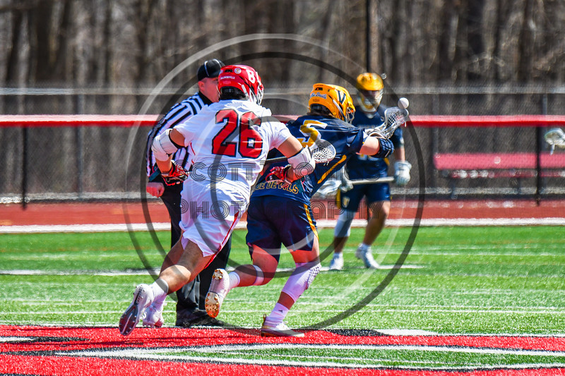 Victor Blue Devils Regan Endres (5) wins a face-off against the Baldwinsville Bees Michael Tangredi (26) in Section III Boys Lacrosse action at the Pelcher-Arcaro Stadium in Baldwinsville, New York on Friday, April 6, 2019.  Victor won 9-7.