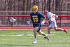 Victor Blue Devils Sutton Boland (33) running with the ball against the Baldwinsville Bees in Section III Boys Lacrosse action at the Pelcher-Arcaro Stadium in Baldwinsville, New York on Friday, April 6, 2019.  Victor won 9-7.