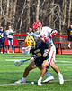 Baldwinsville Bees Michael Tangredi (26) defending against Victor Blue Devils Kevin Caggiano (13) in Section III Boys Lacrosse action at the Pelcher-Arcaro Stadium in Baldwinsville, New York on Friday, April 6, 2019.  Victor won 9-7.