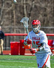 Baldwinsville Bees Austin Bolton (15) passing the ball against the Victor Blue Devils in Section III Boys Lacrosse action at the Pelcher-Arcaro Stadium in Baldwinsville, New York on Friday, April 6, 2019.  Victor won 9-7.