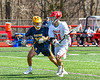 Baldwinsville Bees Braden McCard (31) with the ball against a Victor Blue Devils defender in Section III Boys Lacrosse action at the Pelcher-Arcaro Stadium in Baldwinsville, New York on Friday, April 6, 2019.  Victor won 9-7.