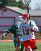 Baldwinsville Bees Braden Lynch (13) with the ball against the Fayetteville-Manlius Hornets in Section III Boys Lacrosse action at the Pelcher-Arcaro Stadium in Baldwinsville, New York on Saturday, April 13, 2019.  Baldwinsville won 16-5.