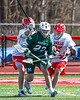 Baldwinsville Bees players and Fayetteville-Manlius Hornets Jack Shanley (22) chase after the ball in Section III Boys Lacrosse action at the Pelcher-Arcaro Stadium in Baldwinsville, New York on Saturday, April 13, 2019.  Baldwinsville won 16-5.