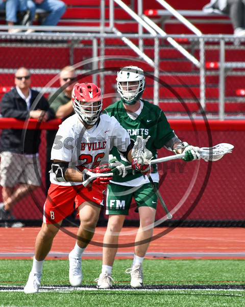Baldwinsville Bees Michael Tangredi (26) with the ball against the Fayetteville-Manlius Hornets in Section III Boys Lacrosse action at the Pelcher-Arcaro Stadium in Baldwinsville, New York on Saturday, April 13, 2019.  Baldwinsville won 16-5.