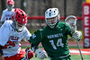 Fayetteville-Manlius Hornets Matthew Wodka (14) with the ball against Baldwinsville Bees Cameron Slink (25) in Section III Boys Lacrosse action at the Pelcher-Arcaro Stadium in Baldwinsville, New York on Saturday, April 13, 2019.  Baldwinsville won 16-5.