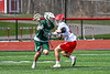 Baldwinsville Bees Braden McCard (31) defending against a Fayetteville-Manlius Hornets player in Section III Boys Lacrosse action at the Pelcher-Arcaro Stadium in Baldwinsville, New York on Saturday, April 13, 2019.  Baldwinsville won 16-5.
