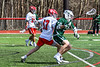 Baldwinsville Bees Caleb Voorhees (17) defending against a Fayetteville-Manlius Hornets player in Section III Boys Lacrosse action at the Pelcher-Arcaro Stadium in Baldwinsville, New York on Saturday, April 13, 2019.  Baldwinsville won 16-5.