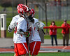 Baldwinsville Bees Austin Bolton (15) is congratulated for his goal against the Fayetteville-Manlius Hornets in Section III Boys Lacrosse action at the Pelcher-Arcaro Stadium in Baldwinsville, New York on Saturday, April 13, 2019.  Baldwinsville won 16-5.
