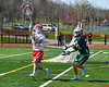 Baldwinsville Bees goalie Daniel Stehle (34) passing the ball against the Fayetteville-Manlius Hornets in Section III Boys Lacrosse action at the Pelcher-Arcaro Stadium in Baldwinsville, New York on Saturday, April 13, 2019.  Baldwinsville won 16-5.