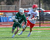 Fayetteville-Manlius Hornets Matthew Wodka (14) with the ball against Baldwinsville Bees Adam Davis (3) in Section III Boys Lacrosse action at the Pelcher-Arcaro Stadium in Baldwinsville, New York on Saturday, April 13, 2019.  Baldwinsville won 16-5.