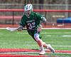 Fayetteville-Manlius Hornets Logan Wilkinson (32) with the ball against the Baldwinsville Bees in Section III Boys Lacrosse action at the Pelcher-Arcaro Stadium in Baldwinsville, New York on Saturday, April 13, 2019.  Baldwinsville won 16-5.