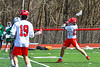 Baldwinsville Bees Connor Steria (12) winds up for a shot at the Fayetteville-Manlius Hornets net in Section III Boys Lacrosse action at the Pelcher-Arcaro Stadium in Baldwinsville, New York on Saturday, April 13, 2019.  Baldwinsville won 16-5.