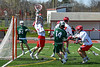 Baldwinsville Bees goalie Daniel Stehle (34) makes a save against a shot by Fayetteville-Manlius Hornets Zach Nestor (14) in Section III Boys Lacrosse action at the Pelcher-Arcaro Stadium in Baldwinsville, New York on Saturday, April 13, 2019.  Baldwinsville won 16-5.