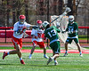 Baldwinsville Bees Braden McCard (31) gets his stick in front of a shot by Fayetteville-Manlius Hornets Luke Daino (13) in Section III Boys Lacrosse action at the Pelcher-Arcaro Stadium in Baldwinsville, New York on Saturday, April 13, 2019.  Baldwinsville won 16-5.