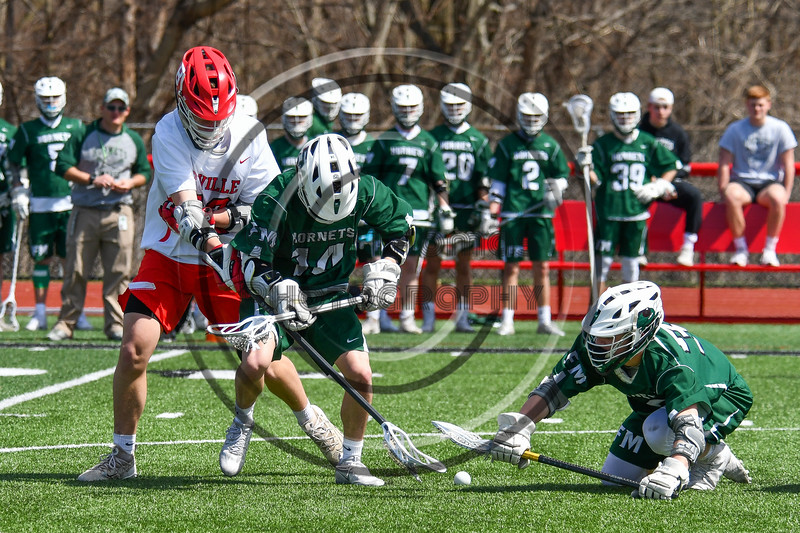 Baldwinsville Bees and Fayetteville-Manlius Hornets players battling for a ground ball in Section III Boys Lacrosse action at the Pelcher-Arcaro Stadium in Baldwinsville, New York on Saturday, April 13, 2019.  Baldwinsville won 16-5.